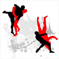 Silhouettes of wrestlers on abstract background.