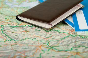 Preparing to travel: passport, tickets, map