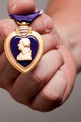 Man Holding Purple Heart War Medal