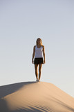 Woman Hiking on Sand Dune poster
