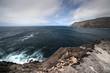 azores, terceira island shore seascape with dark clouds and rock