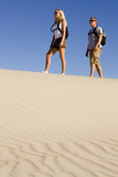 Hikers on a Sand Dune