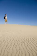 Hiker on a Sand Dune
