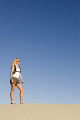 Woman Hiking Through Desert