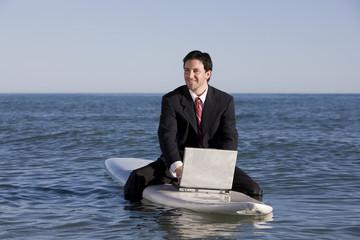 Surfing Businessman