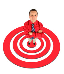 businessman in red shirt standing on red shooting mark collage.