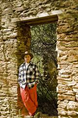 Man in Plaid and Orange in Rock Door
