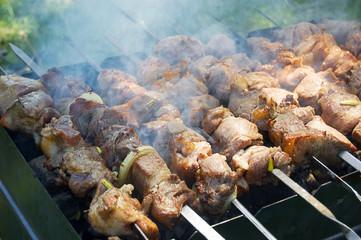 Pork meat slices on fire in foam