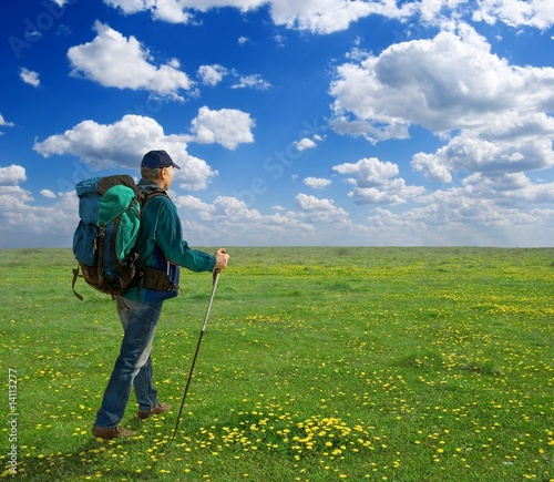 tourist is a going on the flowering field