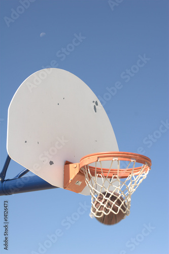 Basketball entering hoop