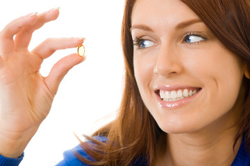 Young woman with Omega 3 fish oil capsula, isolated