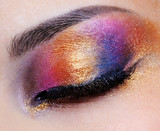 closed eye with multicoloured eyeshadow poster