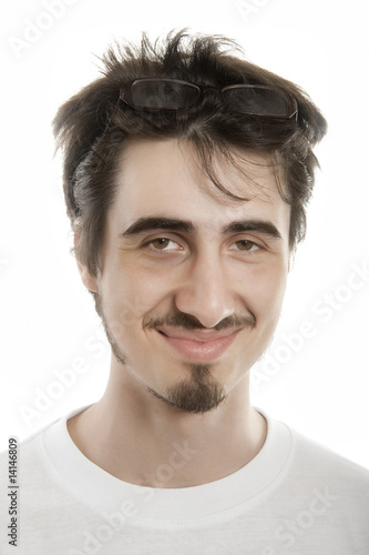 Joyful young man wearing glasses