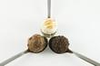 3 truffles on white background III