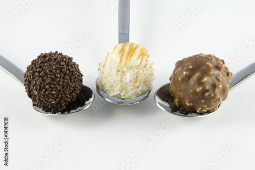 3 truffles on white background