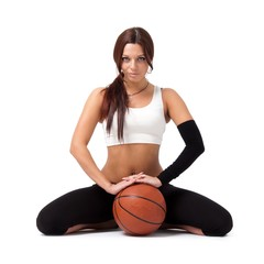 woman with basketball sitting on white background