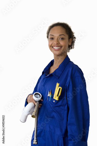 Female plumber with pipes, smiling, portrait, cut out