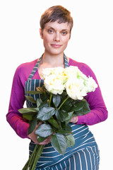 Female florist with bunch of roses, smiling, portrait, cut out