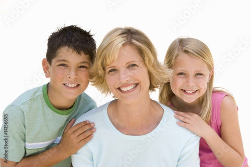 Woman with son and daughter smiling, portrait, cut out