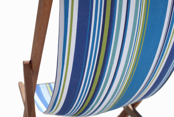 Stripy blue deckchair, mid-section, close-up, rear view, cut out