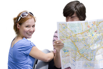 Young couple with map, portrait of woman smiling, cut out