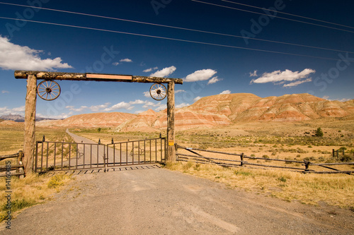 A gate and a fence in desert, wild west - 14160485
