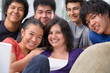 Multi ethnic students pose together