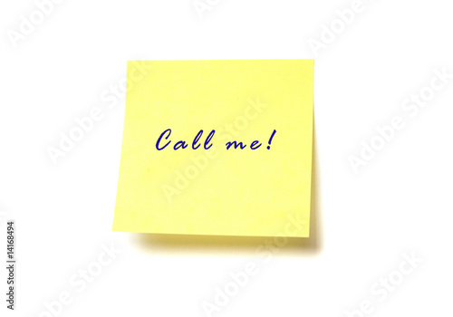 "Yellow post it with words ""Call me!"" isolated on white"