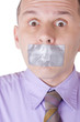 Man with taped mouth