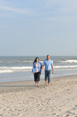 Inter Racial couple walking on the beach