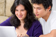 Young couple watching something on laptop