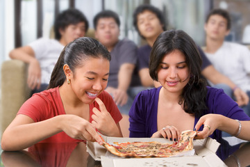 Girls got the first chance to eat pizza