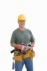 Male builder with hardhat and electric drill, smiling, portrait, cut out