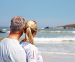 Rear view of a mature couple looking at the waves