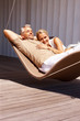 Portrait of an aged couple relaxing in hammock