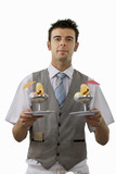 Waiter serving ice cream desserts, front view, portrait, cut out