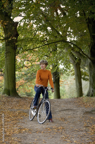 A senior woman riding a bicycle