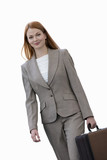 Businesswoman carrying briefcase, smiling, portrait, cut out