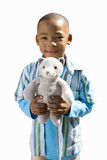 Boy holding stuffed toy, smiling, portrait, cut out