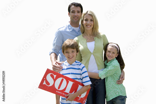 Family with 'sold' sign, smiling, portrait, cut out