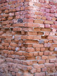 Corner of an old red brick wall - 14193252