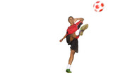Teenage girl in uniform kicking soccer ball, cut out