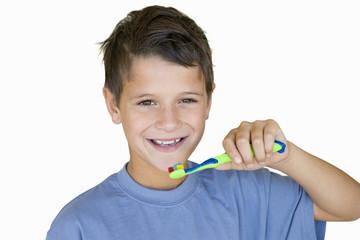 Boy brushing teeth, smiling, portrait, cut out