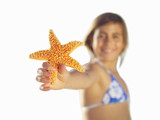 Girl with starfish, close-up of hand, cut out