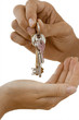 Man handing woman set of keys, close-up of hands, side view, cut out