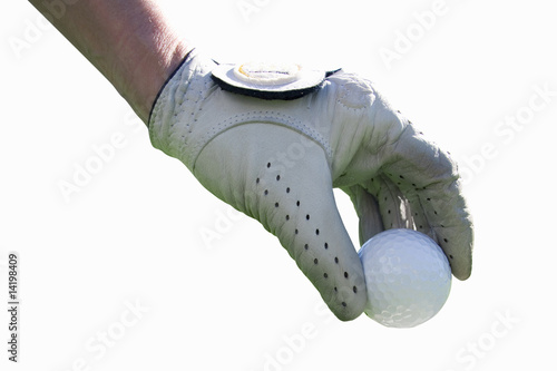 Gloved hand holding golf ball, close up, cut out