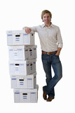 man leaning on pile of boxes, cut out