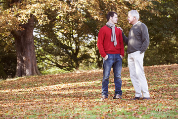 Father and son out walking, having a conversation