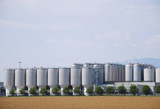 Tall industrial silos in beer industry