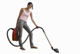 young woman with vacuum cleaner, cut out